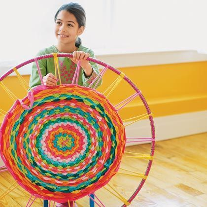 colourful woven made from old t-shirts! this looks like a pretty easy way to recycle some unwanted clothes. all you need is a hula hoop! *can try it with strips of fabric also*