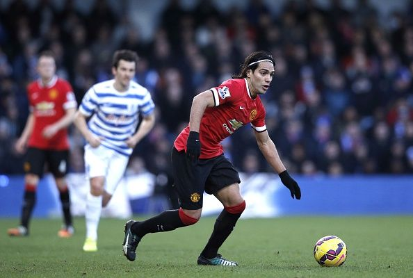 Manchester United's Colombian striker Radamel Falcao runs with the ball during the English Premier League football match between Queens Park Rangers and Manchester United at Loftus Road Stadium in London, on January 17, 2015.