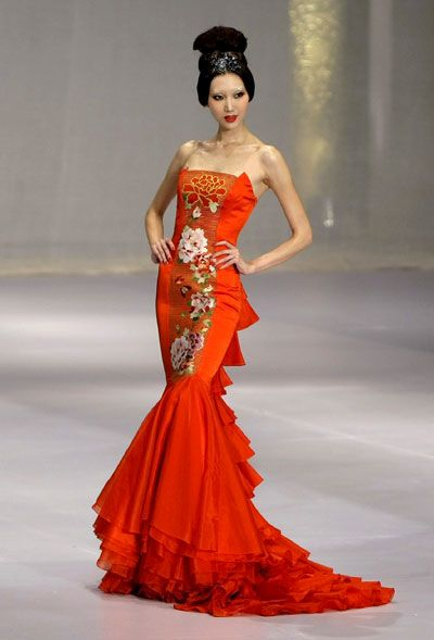 Dramatic. Red orange Asian inspired trumpet dress.  Gorgeous!