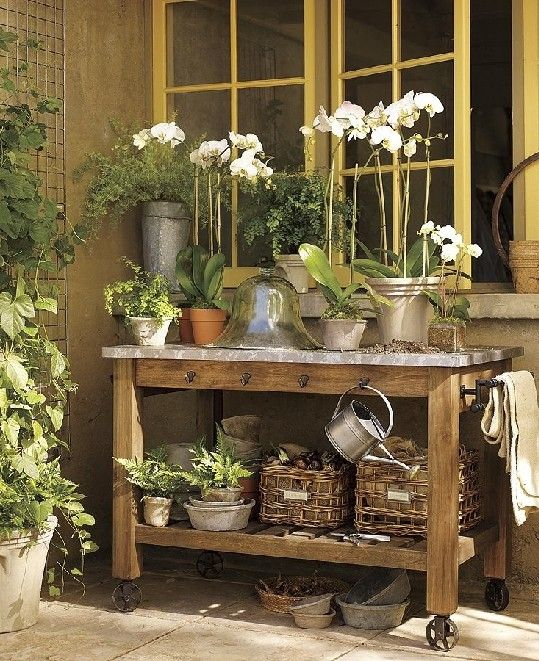 Repurpose an old desk or table for gardening. It could be against the pallet fence, and maybe use pallets to close in under the table & make doors for winter storage. ~B: Gardens Ideas, Pots Tables, Work Benches, Plants, Outdoor Spaces, Flowers, Gardens Tables, Pots Benches, Gardens Benches