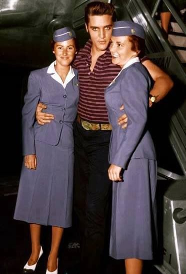 Two stewardess wanted picture with him.   Damn, why didn't I get a picture with him when he was on my flight????  DUMB!!  cm