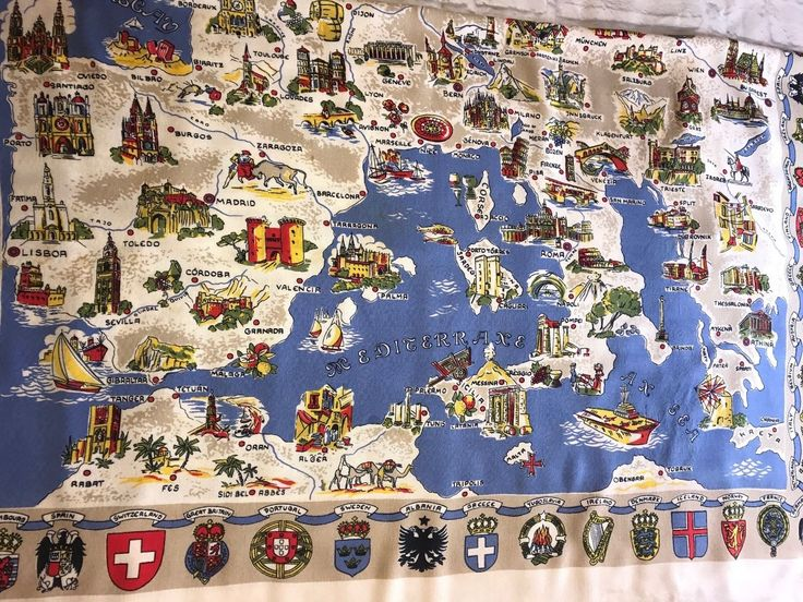 "Vintage German made tablecloth, measures 64"" by 44"", map of Europe. Has Crests and names of countries around the border of the tablecloth, map of Europe with the name of key cities on the main map. Has some stains, but overall very good condition(see pictures). Made of 100% Viscose. 