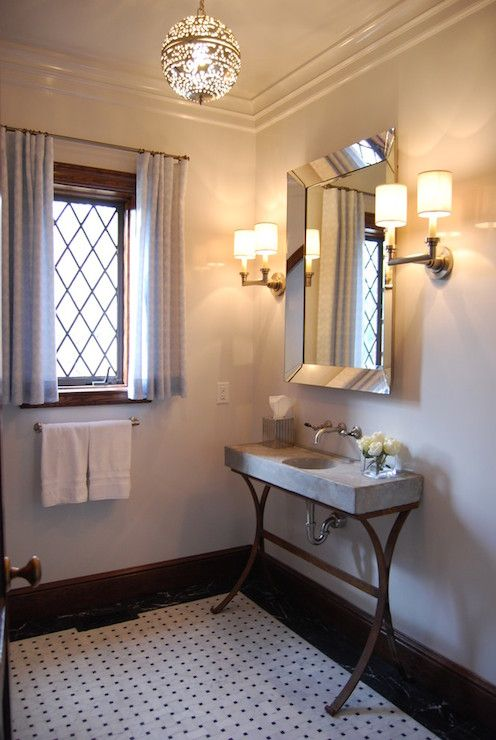 mediterranean bathroom features moroccan pierced lantern over beveled mirror flanked by satin nickel sconces over x based vanity topped with marble sink - Mirror Tile Castle Ideas