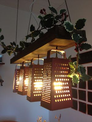 Vintage charm using cheese graters for light fixtures. A little bit country.....
