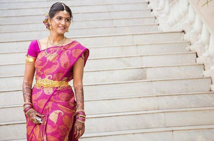 South Indian bride. Temple jewelry. Jhumkis.Pink silk kanchipuram sarees with embroidered blouse.Braid with fresh jasmine flowers. Tamil bride. Telugu bride. Kannada bride. Hindu bride. Malayalee bride.Kerala bride.South Indian wedding.