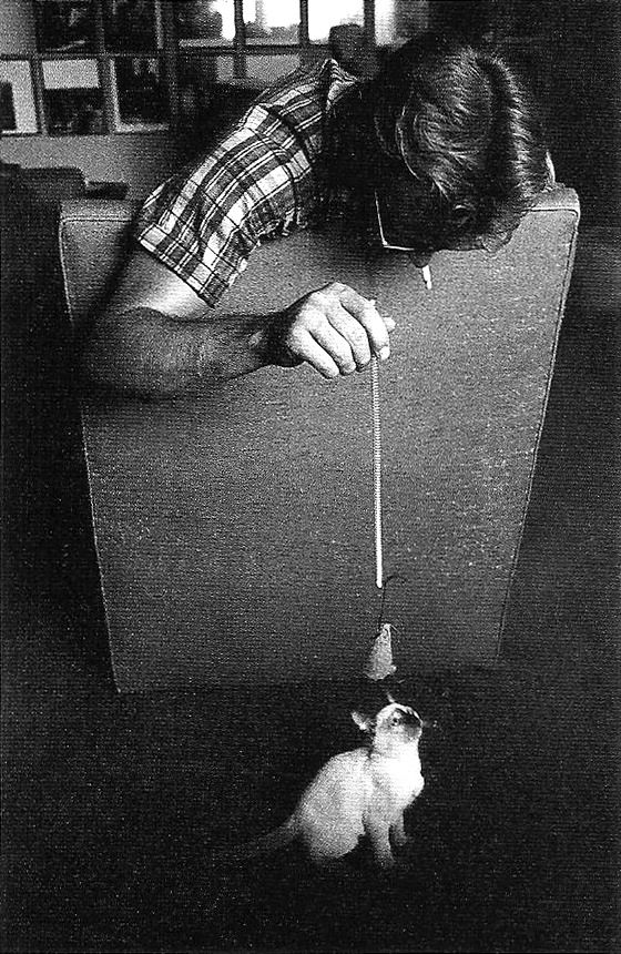 James Dean playing with his gift from Elizabeth Taylor, a kitten he named Marcus. Photos by Sanford Roth, 1955.
