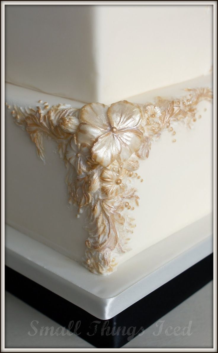 maggie austin bas relief cakes   Ivory & Gold Bas-relief Wedding Cake