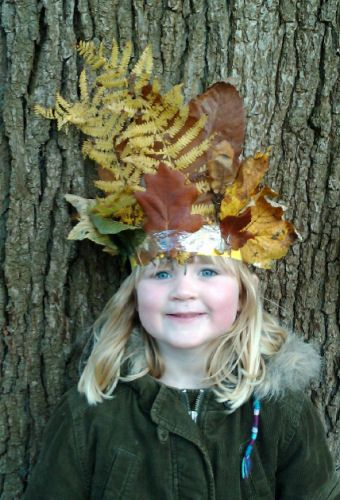 Make a leaf crown - either by leaf stitching with leaf stems or by making a head…