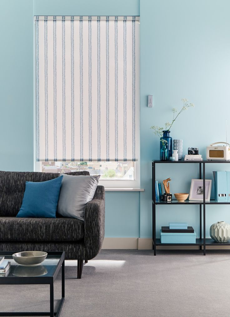 Stripes go hand in hand with blue interiors and are perfect for helping to create a coastal theme in your home. Our Candra Dark Teal Roller blind features a teal graphic design of dots and lines set on white background making it a great choice for nautical inspired living rooms.
