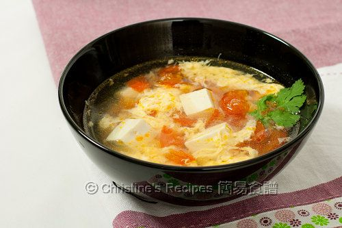 Tomato egg drop soup (didn't have tofu on hand so omitted it. Put lots of spring onions for the fragrance and colour!)
