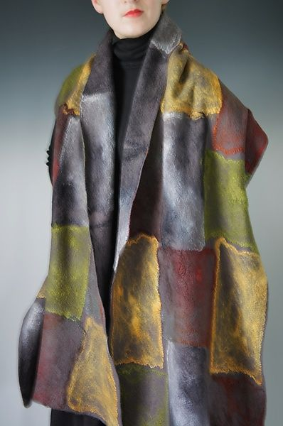 """""""Cambell Wrap in Reverse Multi"""" Created by Elizabeth Rubidge One of a Kind Generous wool wrap with a patchwork of silk patterning on both sides of the piece creating a rich colorful tile design on one side in gold, green, rust and gray and a sophisticated muted gray/black patch on the reverse."""