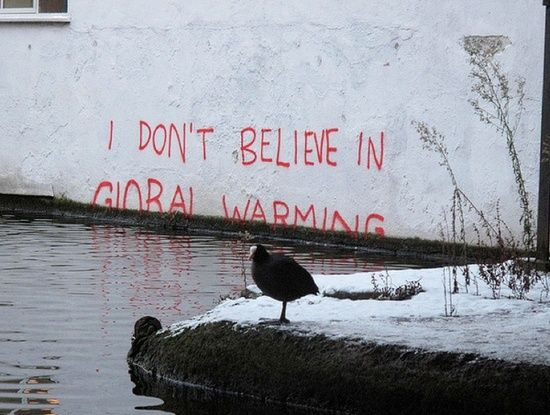 Art work from Banksy, poking fun at climate change deniers. We already see the effects of climate change, including rising sea levels.