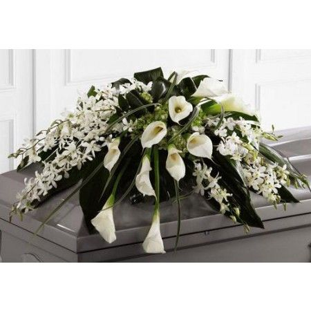 Angel Wings funeral casket spray with orchids and calla lilies
