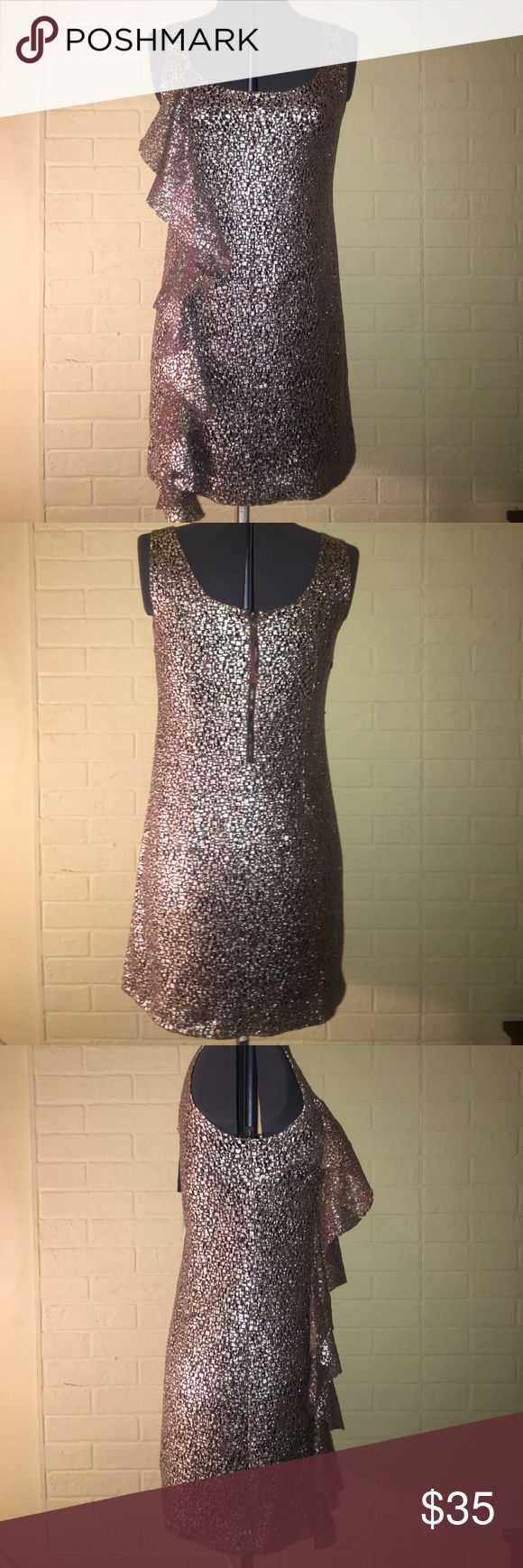 GUESS Ruffled Metallic Party Dress . Size 9 GUESS Ruffled Metallic Party Dress . Gold and Silver. Ruffle detail along one side. Zipper closure in back. Lined. Worn one time. Size 9. *great for a birthday or new years eve ! * Guess Dresses Mini