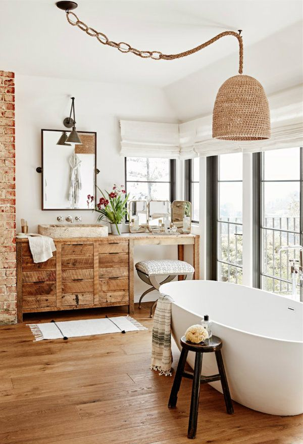 All The Natural Wood Brick And Woven Light Fixture Turn Up The Warmth Factor In The Master Bathroom