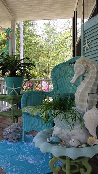 If my porch at the beach was big enough, this would be mine ... so pretty!  coastal porch seahorse fountain