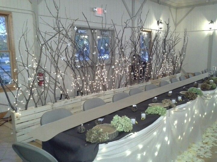 Head table backdrop- tall branches stuck into palettes, twinkle lights