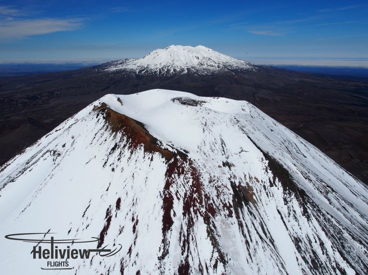 Looking into the crater of Mt Ngauruhoe (Mt Doom in the LOTR Triology), with Mt Ruapehu looking on.
