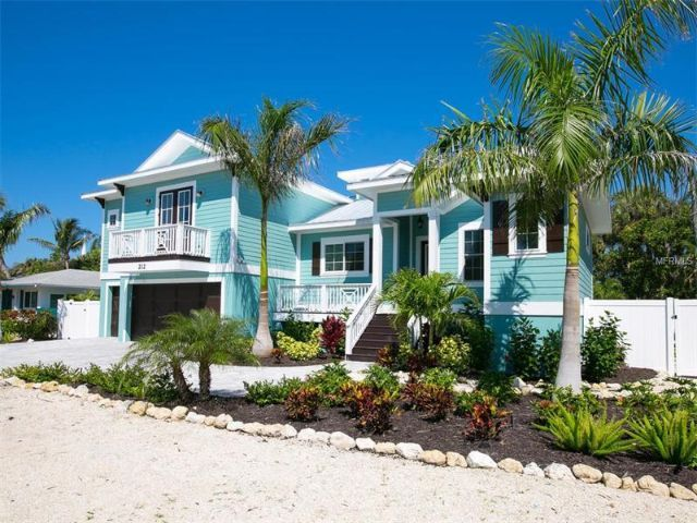 Island Style! Cool Crisp lines make this Island home a delight.  Modern and exquisite decor.  Relax by the pool and hot tub after you had your short walk to the beach. 212 82ND STREET, HOLMES BEACH, FL 34217  #luxuryhomes #realestate #islandliving #Annamaria #beachhomes #LoveFL