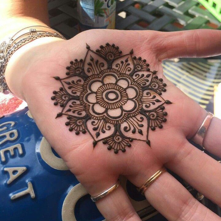 central mendala with fingertips mehendi