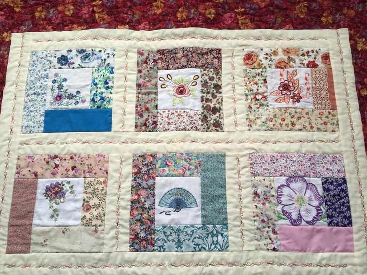 Embroidered panels in the quilt I made for Great Aunt.