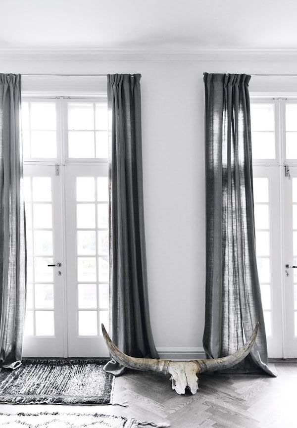 Could also use a lighter blue-grey for the curtains. This would also warm things up. That and a couple of accents might do the trick