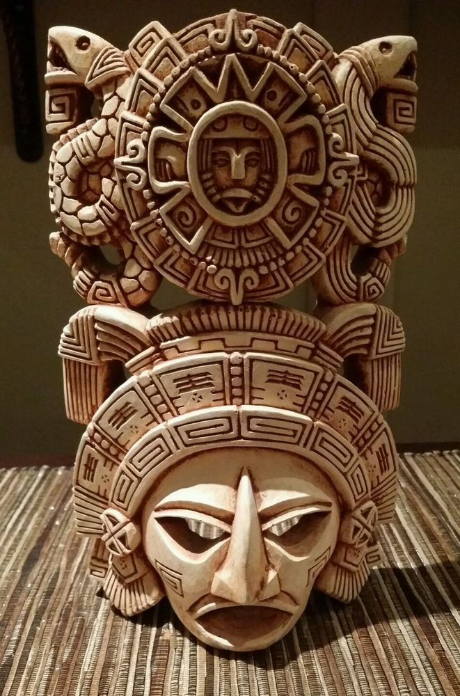 Vintage clay pottery tribal mask from Mexico with an intricate cultural design. Has hook for hanging or can stand as shown in photos. There are two chips on the mask, but nothing that is quite noticeable or detracts from the mask's beauty.