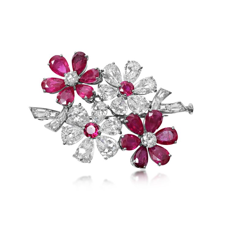 A Ruby and Diamond Brooch with Matching Ear Clips, by Van Cleef & Arpels, circa late 1950's - Sold