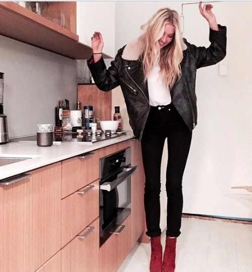 black leather motorcycle jacket + white tee + black skinny jeans + red ankle boots