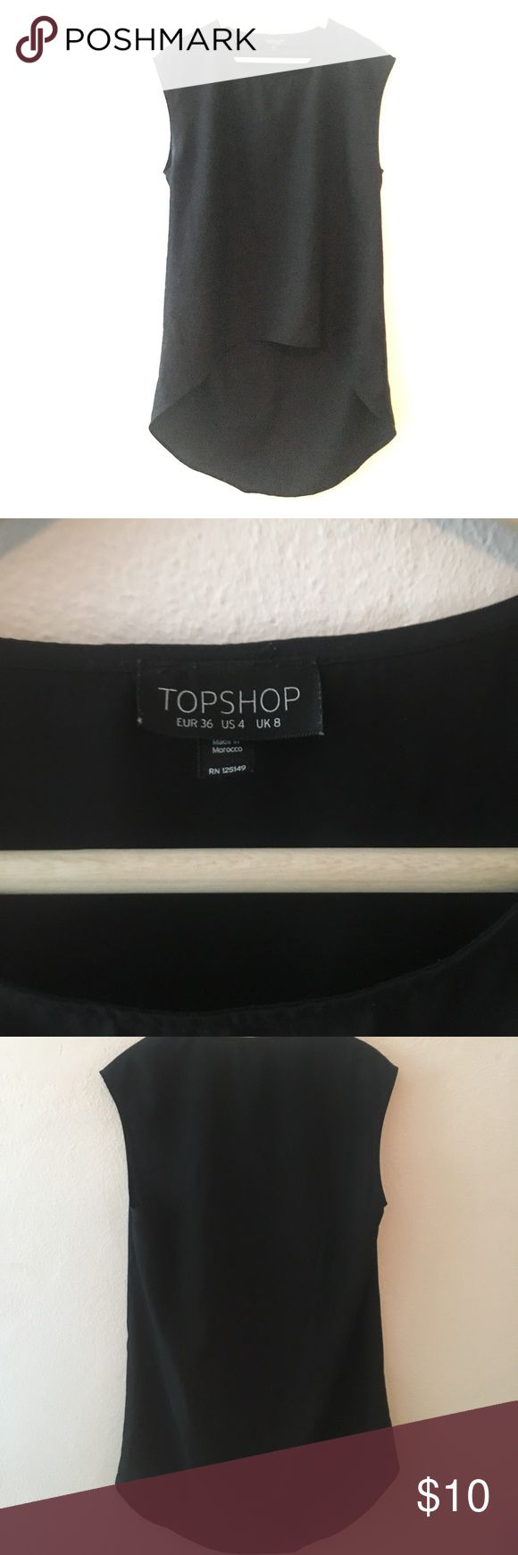 Topshop high low top Topshop top- higher in front and lower in the back. Made of a poly blend 20 inches in the front and  35 inches in the back Topshop Tops