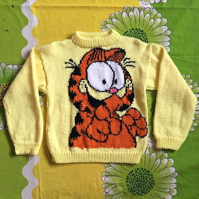 """😻 Hand made Garfield Sweater! 😻Someone's grandma must've loved them a lot to knit this amazing Garfield sweater for them! I'm assuming this was made for a kid but looks super cute as a fitted or cropped sweater. Fits like a SmallChest: 36"""" Length: 19"""" Arm length from shoulder: 18"""" $25 + shipping ✨ SOLD ✨"""