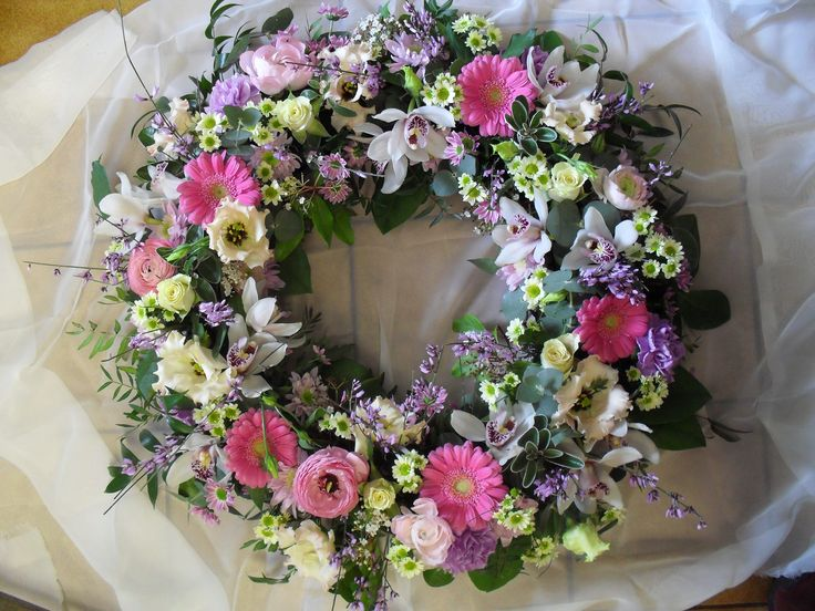 Beautiful large wreath in soft, pastel shades. lilacs, peaches, pinks and creams.  By Dilly at The Rosebud.