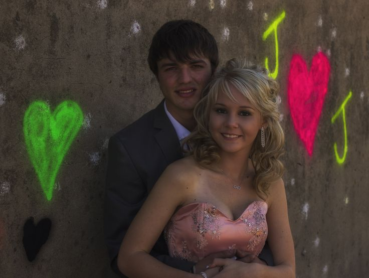 Matric farewell couple shoot ideas with a sprayed wall (Prom photos)