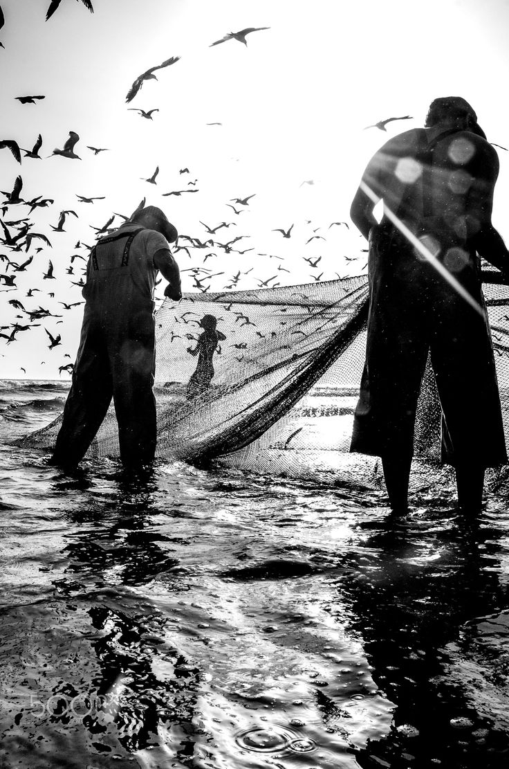 Fishermen - Fishermen work during tourist season