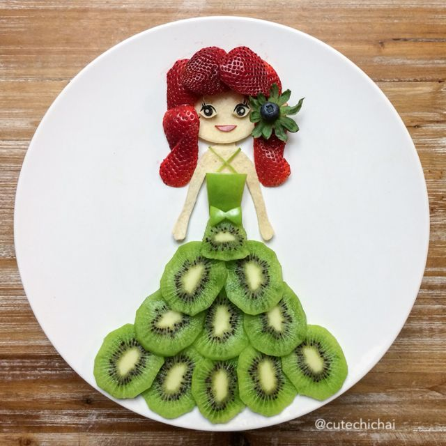Food Art. The girl in green. She is made with strawberries, kiwis, green apple, cheese and nori.