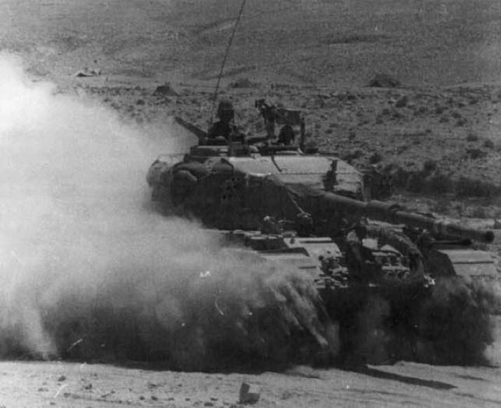 An Israeli Centurion tank plows through the Sinai Peninsula during the Six-Day War in 1967. Taking various provocations from the Arab states to be acts of war - the blockade of the Straits of Tiran being the last straw, Israel launched air attacks on...