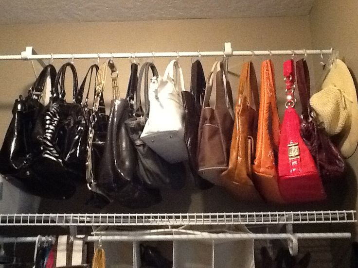 Purses hanging on shower curtain rings