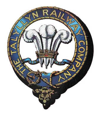Talyllyn Railway Crest - The Talyllyn Railway (Rheilffordd Talyllyn) is a narrow gauge preserved railway in Wales running for 7.25mi from Tywyn on the Mid-Wales coast to Nant Gwernol near the village of Abergynolwyn. The line was opened in 1866 to carry slate from the quarries at Bryn Eglwys to Tywyn, and was the first narrow gauge railway in Britain authorised by Act of Parliament to carry passengers using steam haulage.