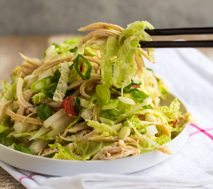 After a little holiday indulgence (or overindulgence!), this yummy salad makes us love to detox. It's super-simple and really satisfying, thanks to protein-rich lean chicken, alkalizing napa cabbage, cleansing daikon radish, and an awesome gingery dressing.