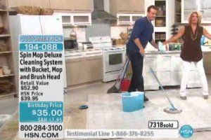 Spin mop deluxe cleaning system with 2 mop heads