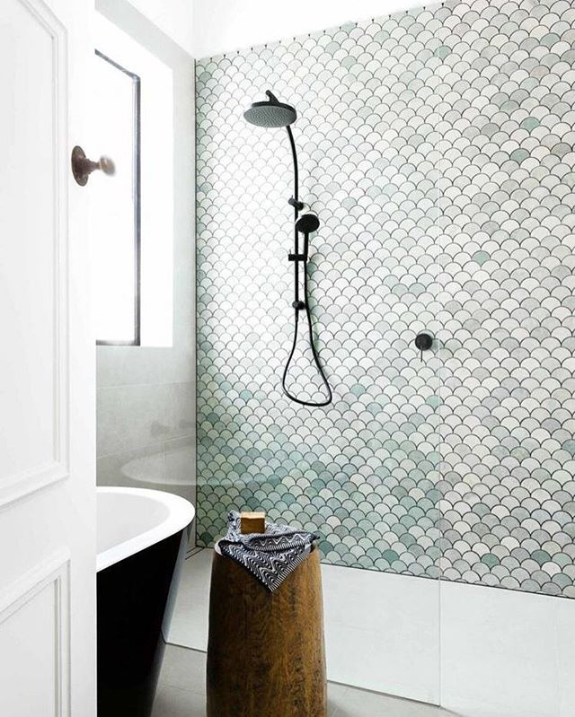 Loving this pale green tile with black fixtures in this bath by @petrinaturnerdesign @amorfophotography @insideoutmag #bathroom