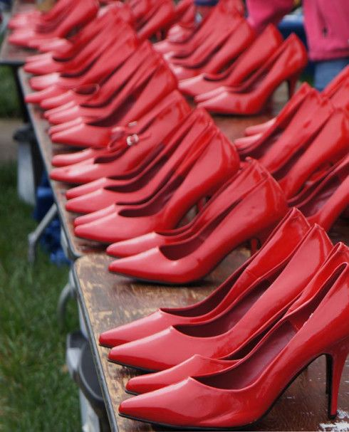 Red heels for walk a mile in her shoes walk