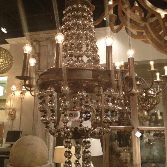 Spellbound chandelier with mercury glass balls hand applied cupertino and antique silver finish hand applied on wrought iron. Huge trend to overscale lighting! Currey & Co.