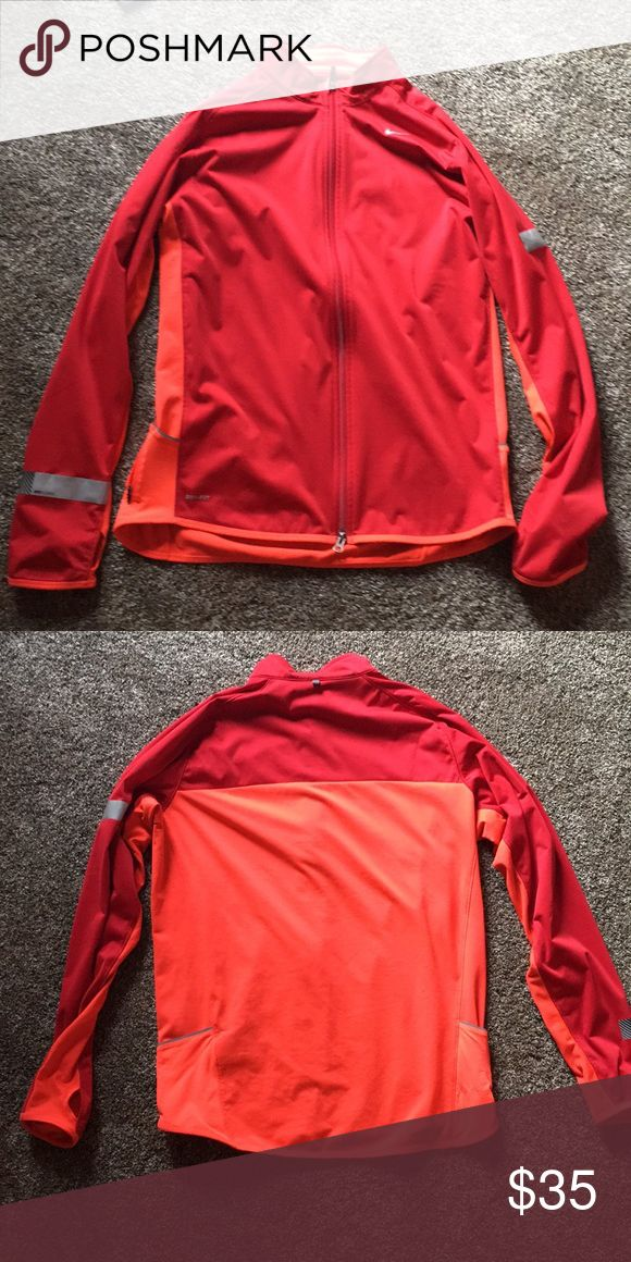 Nike Running Jacket Barely worn. Red and orange jacket. Great for running Nike Jackets & Coats Performance Jackets