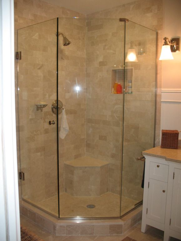 i like the corner shower the frameless shower doors are tempered glass like a car windshield so i coated them with rain x to keep them spot free