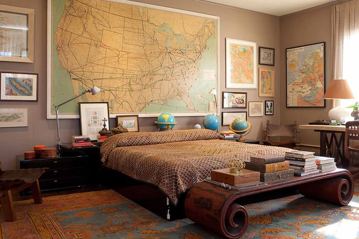 masculine bedroom using globes and world maps as art and accent is cool
