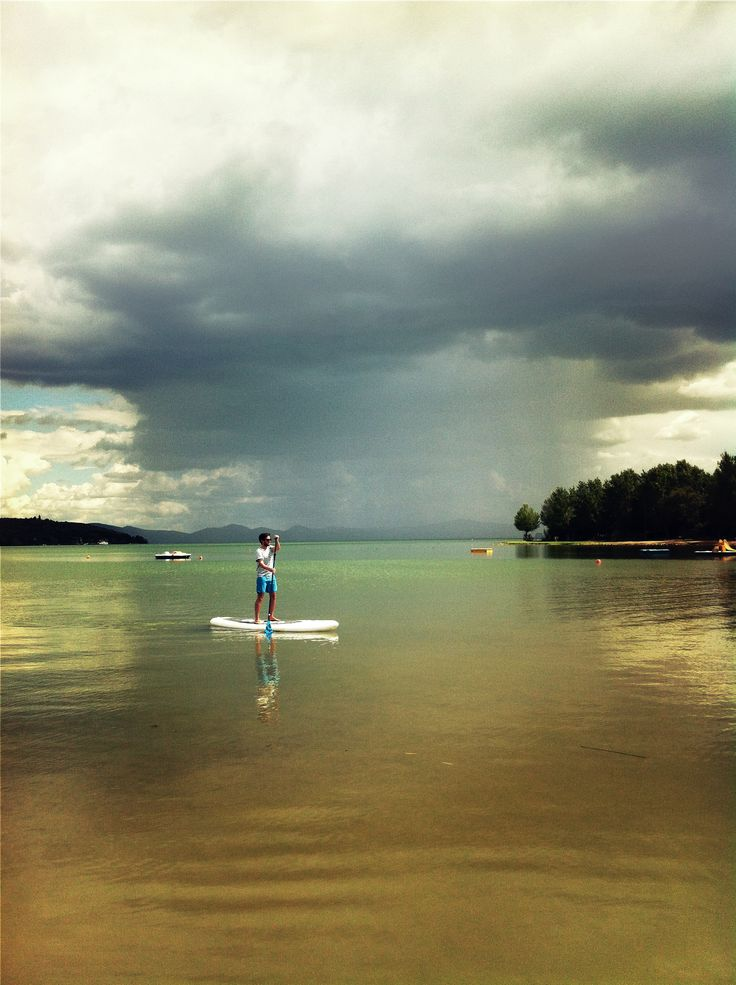 The calm before the storm. Origin Paddleboards cofounder Neal Carter-James testing the new 10'0 classic inflatable SUP just as the storm approaches from behind