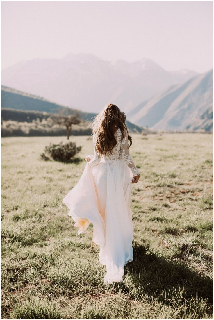 Lace wedding dress and mountain scenery is perfect for a wedding shoot!