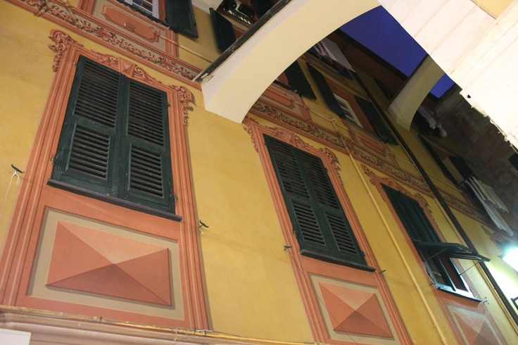 Buildins very close to each other... in a narrow street of the old town of Loano. Trompe l'oeil decorations at the windows.