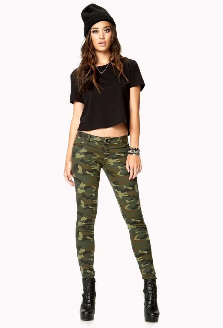 A pair of camouflage skinny jeans featuring zip cargo pockets and cuffs. Seven-pocket construction. Zip fly with a button closure. Woven. Lightweight - Size - 24/XXS (Missing Tag see Measurements) - W